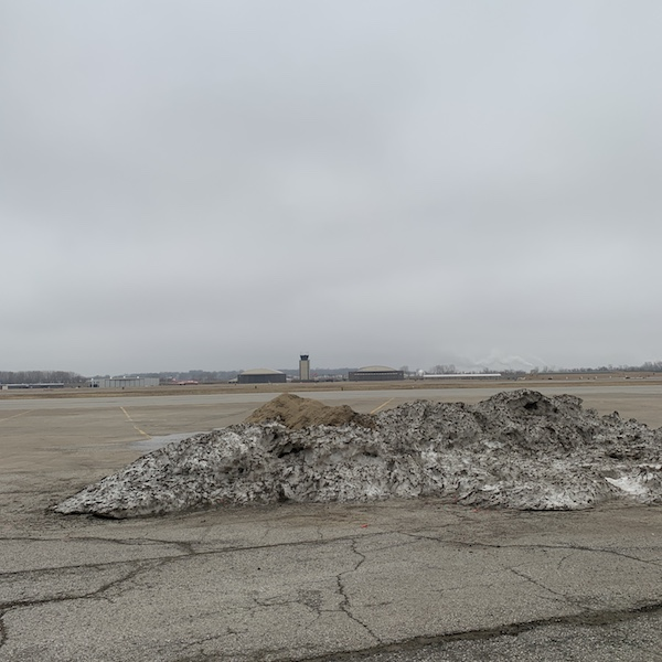 A pile of dirty snow and sand.