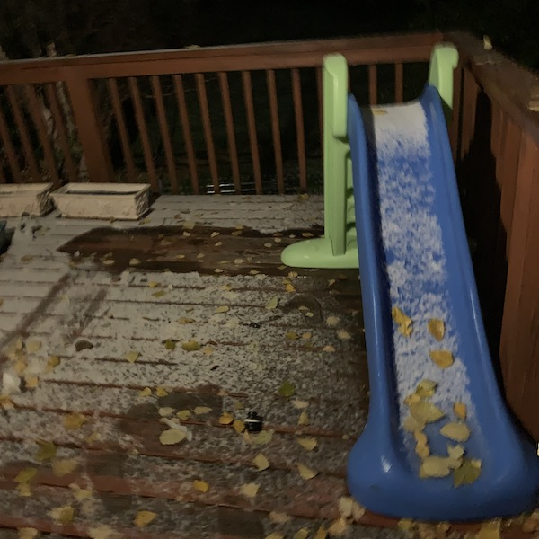 Image of a deck with light snowfall.