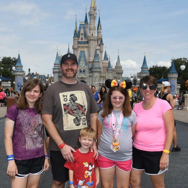 The Gruber family at Disney World in from of Cinderella's Castle.